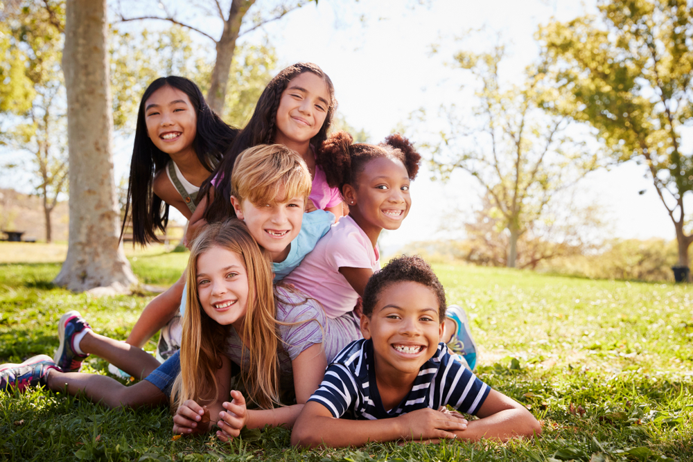 Multi-ethnic,Group,Of,Kids,Lying,On,Each,Other,In,A