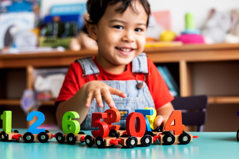 Little,Boy,Playing,Mathematics,Wooden,Toy,At,Nursery